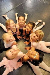 Little dancers, looking at camera in circle